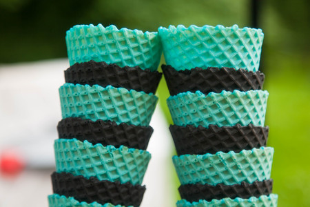 Turquoise and black cones for ice cream inserted into each other