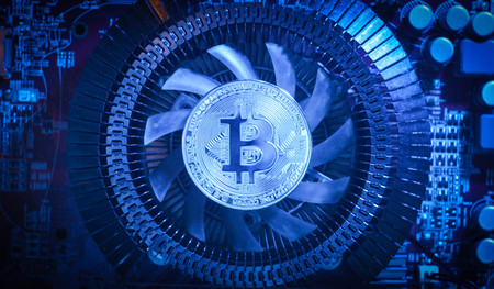 silver coin bitcoin on the fan in the blue light