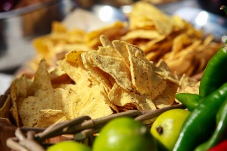 a plate of corn chips nachos in a street cafe on a Sunny day
