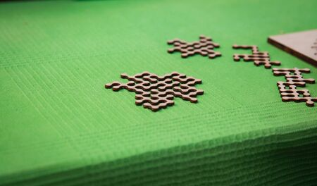 Photo wooden jigsaw puzzle scattered on green cloth. Background Stok Fotoğraf