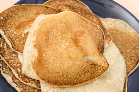 Fried thin pancakes made from wheat flour close up Photo
