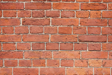 Reliable Red Brick Wall. Strong Brickwork. Protective Structure. Old Bright, Red And Orange Brickwall Texture. 版權商用圖片