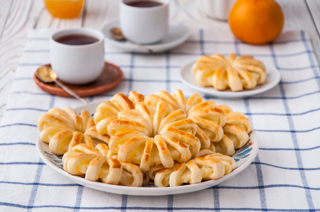 Pineapple ringlets in puff pastry, baked in the form of flowers