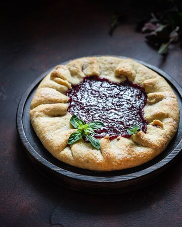 Homemade open cake made of red currant shortcrust pastry, gallette