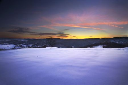 Winter landscape on mountains fields and meadows Countryside of Serbia during winter season. photo