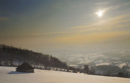 evenings: Winter season views from fields and meadows and forests and mountains. Stock Photo