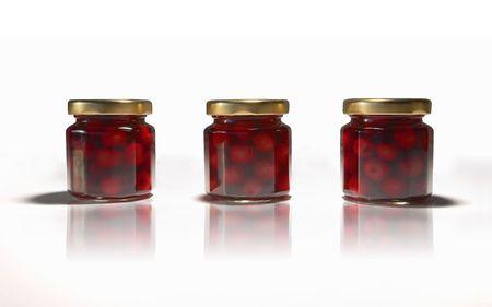 Three bottles of red cherries. Stock Photo - 6628194