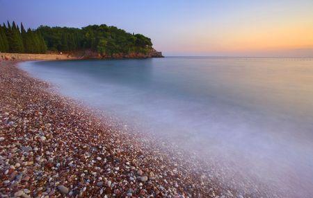 Montenegro beach at sunset summer season. Stock Photo