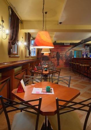 Interior of a cafe-restaurant. Retro design in yellow, red and brown colors.  photo