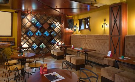 Interior of a cafe-restaurant. Retro design in yellow and brown colors.  photo