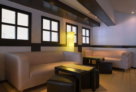 Interior of cafe bar. Minimal modern design with white walls, yellow lamp and white beds. photo