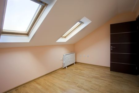 Interior of an empty new loft room with two roof windows. photo