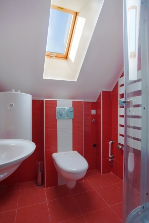 New small apartment bathroom in red. Stock Photo - 8551776