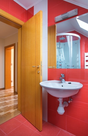 New small apartment bathroom in red. Stock Photo - 8551785