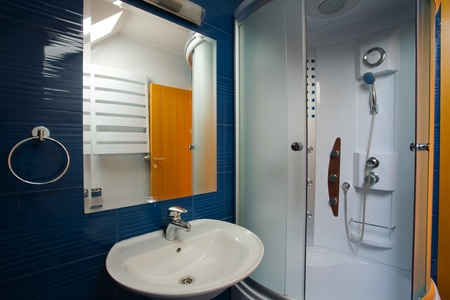 New small apartment bathroom in blue.