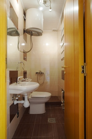 New small apartment bathroom in brown. Stock Photo - 8551786