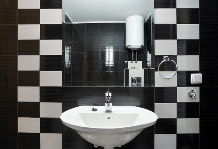 New small apartment bathroom in black. photo
