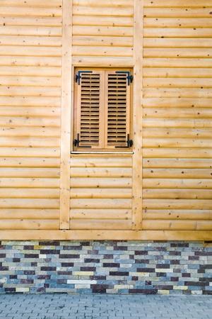 Facade of a new wooden house. Stock Photo - 8658569