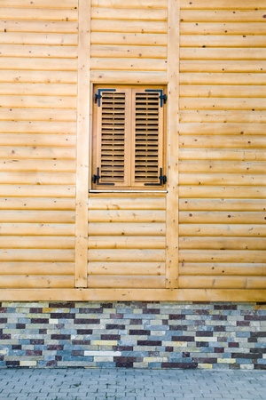 Facade of a new wooden house. Stock Photo - 8658569