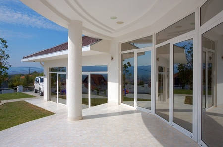 large doors: Modern house exterior, large and expensive house architecture. Stock Photo