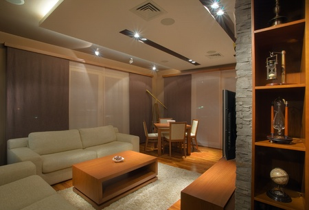 Modern interior of an apartment with handmade furniture and lighting equipment. photo
