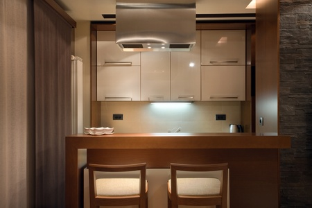Interior of a kitchen, modern minimal style with wooden furniture and lighting equipment. photo