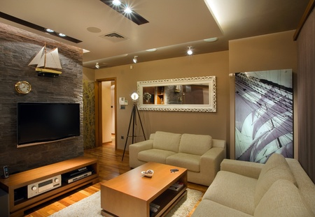 Modern interior of an apartment with handmade furniture and lighting equipment.