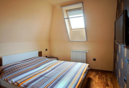 Interior of a bedroom, with modern furniture and light equipment.  photo