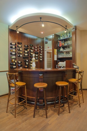 nightspot: Interior of a small cafe, view on a wooden bar. Stock Photo