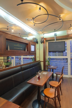 nightspot: Interior of a small cafe, old fashioned style mixed with modern media equipment.