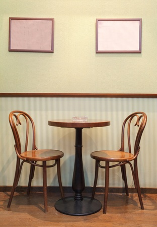 masalar: Details of an interior of a small cafe. Just chairs, empty frames and tables. Stok Fotoğraf