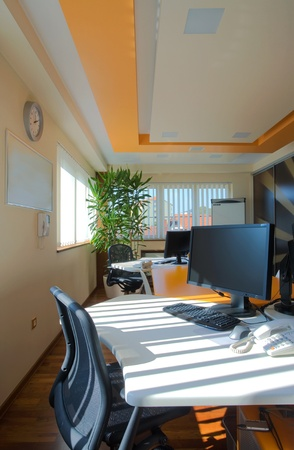 Interior of an office, modern and simple furniture and lighting equipment.  Stock Photo - 8733222