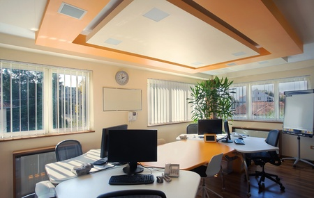 Interior of an office, modern and simple furniture and lighting equipment. Stock Photo - 8733224