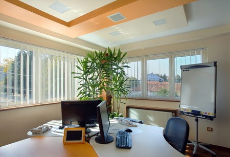 workplace: Interior of an office, modern and simple furniture and lighting equipment.  Stock Photo
