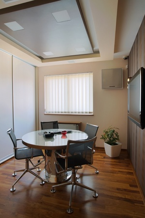 Interior of an office, modern and simple furniture and lighting equipment.  Stock Photo - 8733223