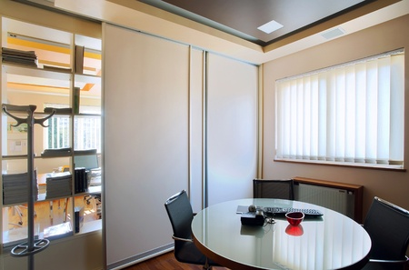 commercial building: Interior of an office, modern and simple furniture and lighting equipment.  Stock Photo