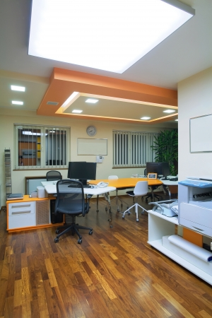 Interior of an office, modern and simple furniture and lighting equipment.  Stock Photo