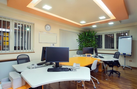 Interior of an office, modern and simple furniture and lighting equipment.  photo