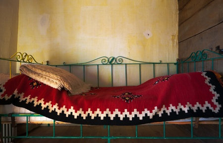 blanketed: Old metal bed, traditional retro vintage style.