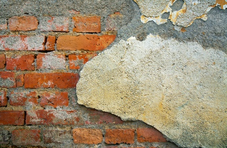 Details of an old ruined brick wall. photo