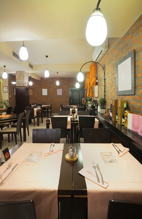 Tables, chairs and brick wall, interior of a restaurant. Stock Photo - 9009629