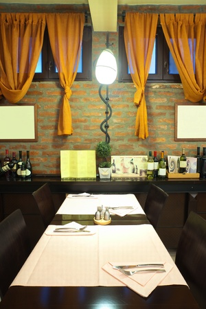 Tables, chairs and brick wall, interior of a restaurant. Stock Photo - 9009643