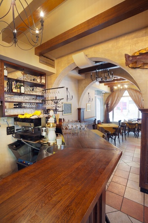 Tables, chairs and lighting equipment of a restaurant. photo