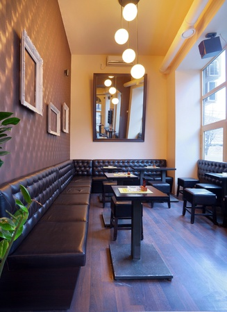 bistro cafe: Interior of a pub with furniture during day. Stock Photo