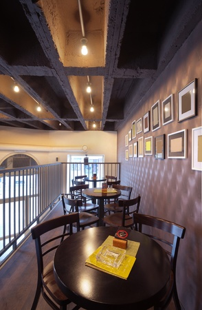 Tables, chairs and empty picture frames on the wall of the pub. photo