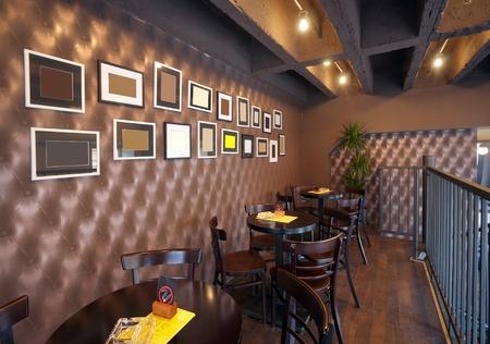 comercial: Mesas, sillas y marcos vac�os en la pared de un pub. Foto de archivo