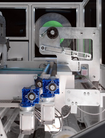 packaging equipment: Details of a packaging machine for rolls, serviettes and handkerchiefs. Stock Photo