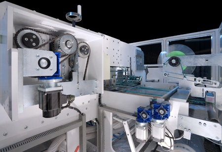 packaging industry: Details of a packaging machine for rolls, serviettes and handkerchiefs. Stock Photo