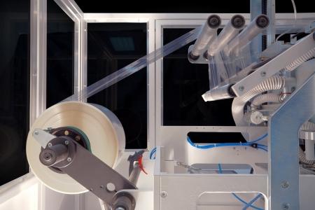 kunststoff: Verpackungsmaschine f�r Rolls, Servietten und Taschent�cher.  Lizenzfreie Bilder