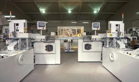 Machines for making handkerchiefs, rolls and serviettes.  photo